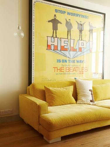 Beatles poster and a yellow sofa.