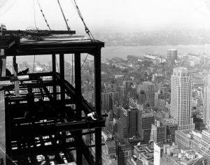 Building the Empire State Building that would be the tallest building in the world