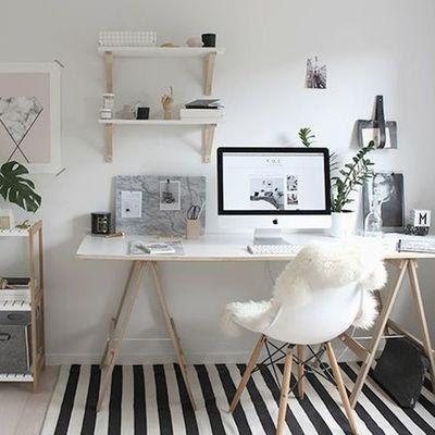 Home office with light colors and plants giving a decorative touch
